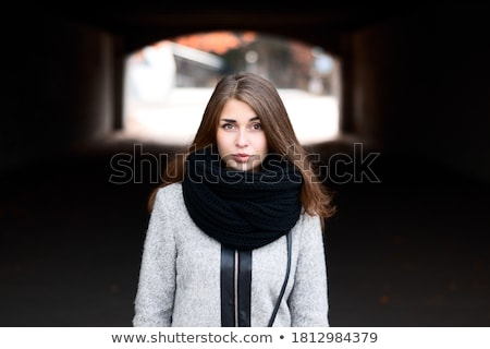 close up portrait of pretty young lady with stylish makeup and curly long hair big lips soft skin stock photo © elenabatkova