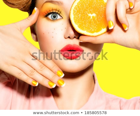 Beautiful model girl with red manicure on nails with bright make Stock photo © dashapetrenko