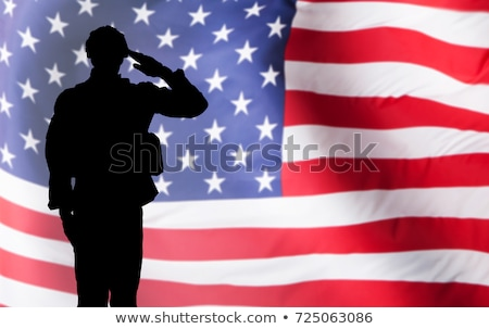 Solider Saluting Against The American Flag Stock photo © AndreyPopov