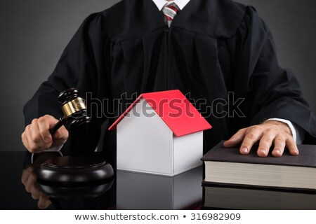Judge Holding Gavel On House At Desk Stock photo © AndreyPopov