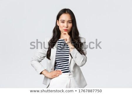 Bella giovani signora elegante suit guardando Foto d'archivio © pressmaster