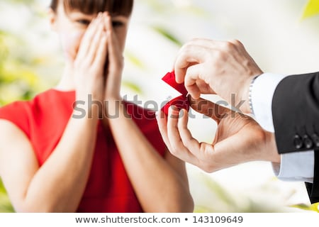 man with diamond engagement ring in red gift box Stock photo © dolgachov