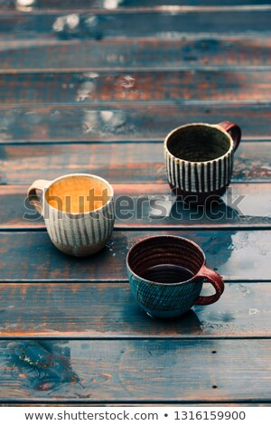A couple of earthen cups with coffee and herbal tea on wooden we Stock photo © przemekklos
