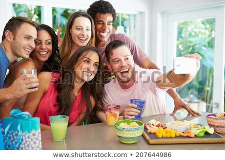 happy friends taking selfie at home party Stock photo © dolgachov