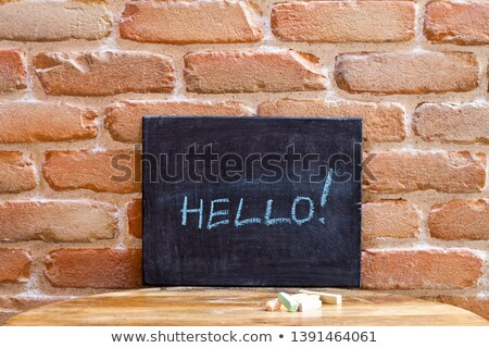 Black board with the word HELLO! drown by hand on wooden table o Stock photo © marylooo