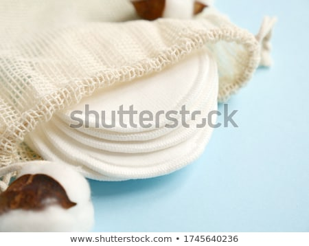 Organic cotton pads on blue background, cosmetics and make-up re Stock photo © Anneleven