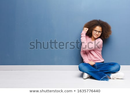 happy little african american girl showing power stock photo © dolgachov