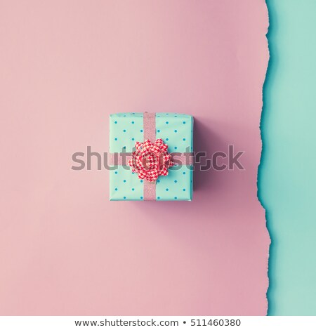 Small gift with pink ribbon on table Stock photo © Sandralise