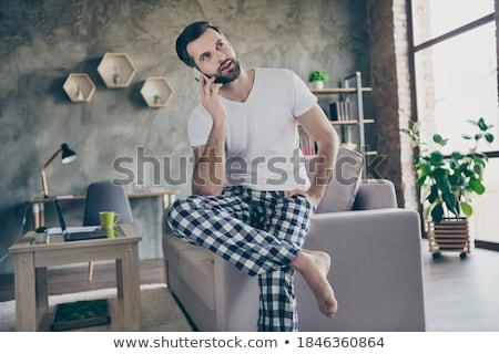 Fotó fiatalember visel kockás póló beszél Stock fotó © deandrobot