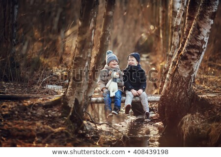 Stockfoto: Family With Boy And Dog In Autumn Wood