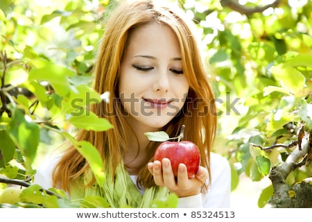 Stock fotó: Beautiful Young Redhead Woman Standing Near The Apple Tree