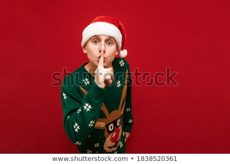 shh. secret - Young boy with his finger over his mouth  Stock photo © dacasdo
