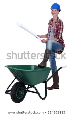 female bricklayer with leg resting on wheelbarrow Stock photo © photography33