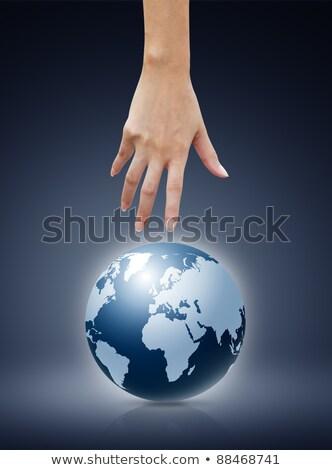 Photo stock: Femmes · main · pointant · vers · le · bas · monde · bleu