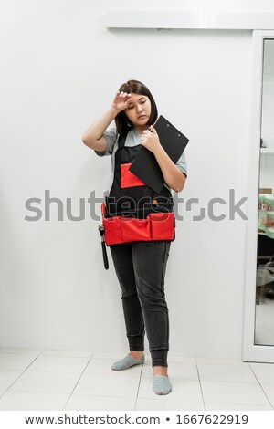 Tired female laborer at construction site Stock photo © photography33