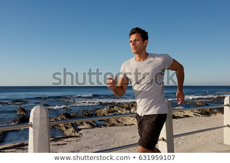 Orta yaş adam jogging plaj tok Stok fotoğraf © pedromonteiro