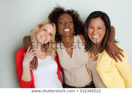 счастливым · группа · женщины · указывая - Сток-фото © HASLOO