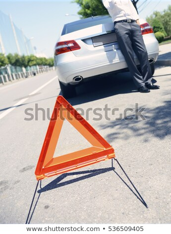 Man awaiting roadside assistance Stock photo © photography33