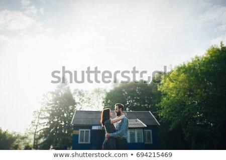 Pár ölel kívül épület család ház Stock fotó © photography33