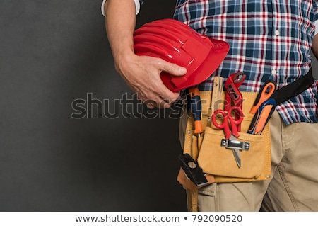 Helmeted Craftsman with tools Stock photo © photography33