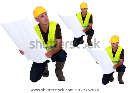 Multiple shot on foreman with plans kneeling Stock photo © photography33