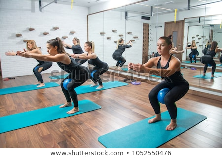Stock photo: Pilates aerobic women group with stability ball