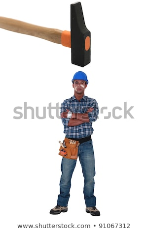 injured laborer with big hammer over the head stock photo © photography33