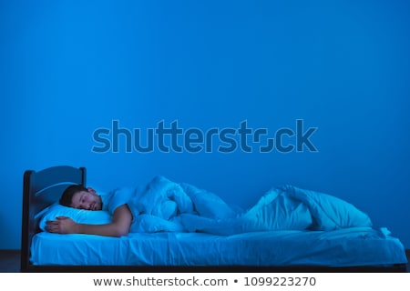 handsome young man asleep in bed stock photo © photography33