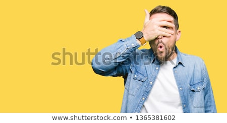 young man covering eyes stock photo © photography33