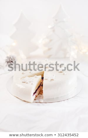 icing on christmas cake with tree lights stock photo © backyardproductions