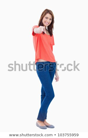 Adolescent pointing her finger while leaning her head to the side Stock photo © wavebreak_media