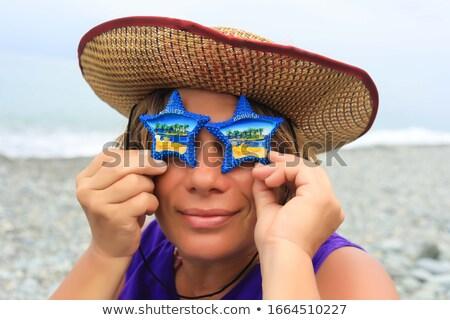 Młoda kobieta stałego plaży Rozgwiazda powrót Zdjęcia stock © wavebreak_media