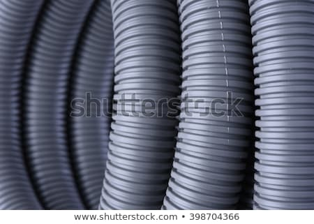 corrugated pipe for electrical cables coiled in a circle stock photo © arezzoni
