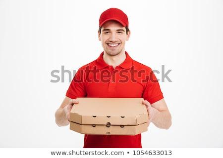 Cheerful delivery man holding pizza stock photo © wavebreak_media