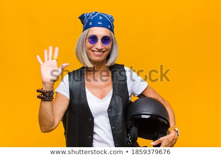 Woman driver smiling and greeting you by hand Stock photo © Nobilior