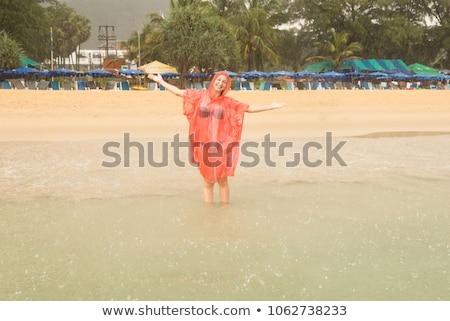 Młodych piękna kobieta bielizna płaszcz przeciwdeszczowy kamienie kobieta Zdjęcia stock © pxhidalgo