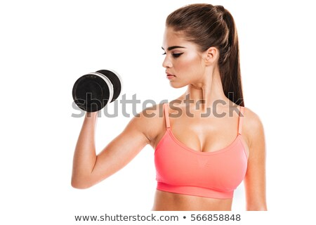 Woman exercising with heavy dumbells Stock photo © ivonnewierink