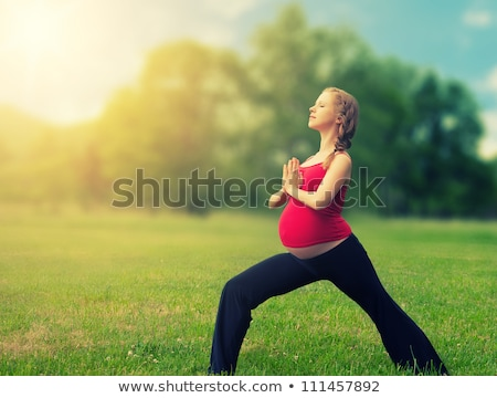 Healthy pregnant woman doing yoga in nature  Stock photo © dashapetrenko