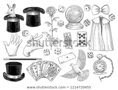 magician in hat showing trick with playing cards stock photo © dolgachov