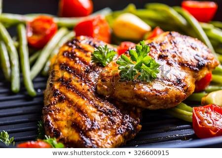 Grillcsirke mell zöldségek tányér villa fehér Stock fotó © Virgin