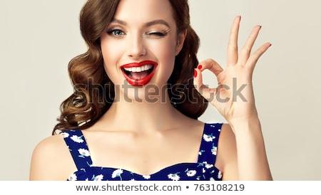 Beautiful Woman WInking Stock photo © piedmontphoto