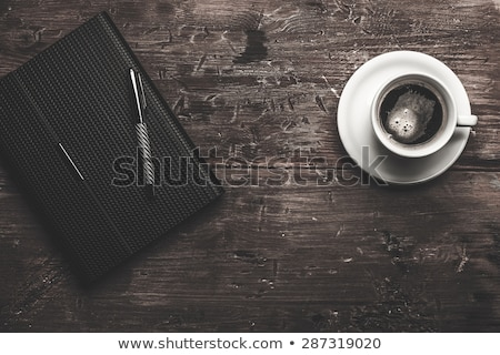 businessman - writing in organizer Stock photo © dgilder