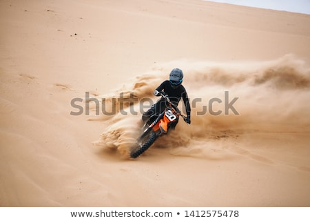 racer on a motorcycle in the desert Stock photo © OleksandrO