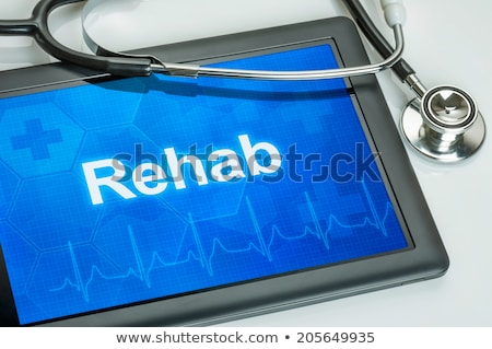 Tablet with the text Rehab on the display Stock photo © Zerbor