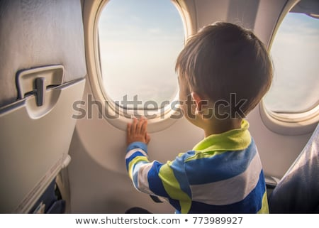 boy looks at the plane at the airport stock photo © d13