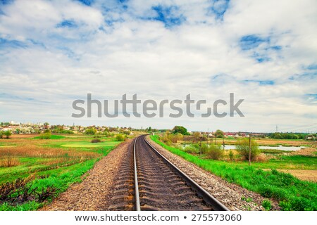 railroad tracks and blue sky with clouds landscape stock photo © goce