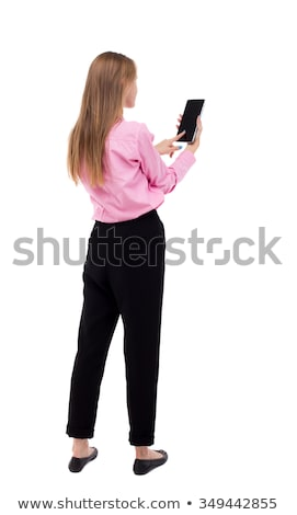 back view portrait of a woman holding tablet computer stock photo © deandrobot