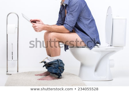Stock photo: Man In Toilet Using Laptop