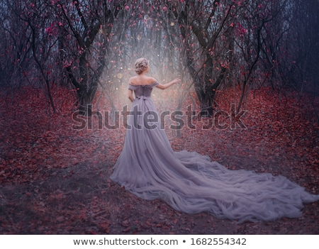fashion elegant blond woman model in red gown with long train of stock photo © victoria_andreas