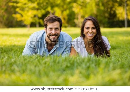 Despreocupado Pareja parque sonriendo cámara Foto stock © wavebreak_media